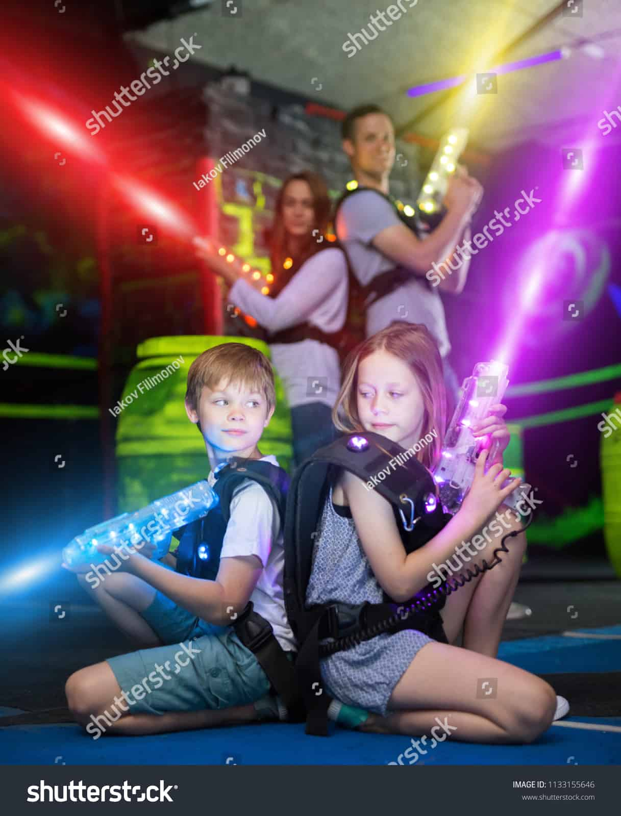 Stock Photo Happy Little Brother And Sister Sitting Back To Back In